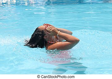 Cooling off - A young lady cooling off in a swimming pool...