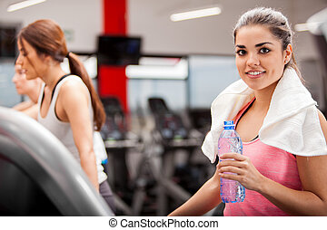 Cooling off after working out - Cute Hispanic brunette...