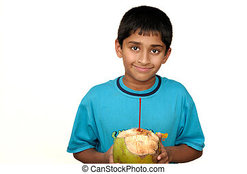 Cooling Off - Ajn handsome Indian kid drinking coconut water...