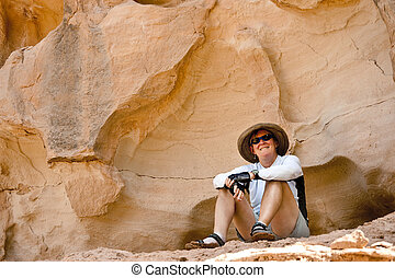 Cooling off - Woman cooling off and relaxing in shade in the...