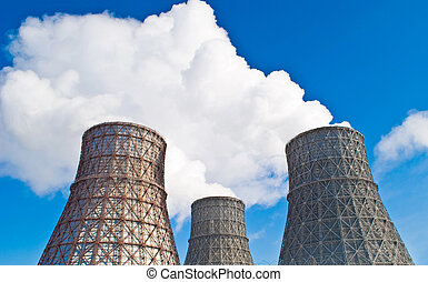 cooling tower against the blue sky