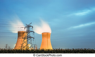 cooling tower of power plant in nightfall