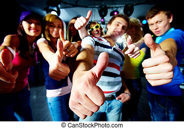 Coolness - Photo of friends showing thumbs up meaning cool...