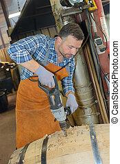 cooper drilling a barrel