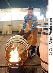 cooper heating a barrel