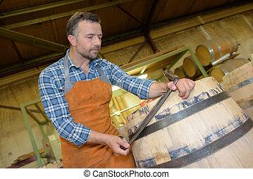 Cooper working on barrel