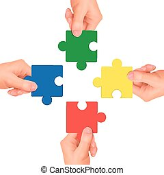 cooperation concept: hands holding jigsaw pieces over white...