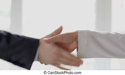 Cooperation - Close-up of business partners shaking hands to...