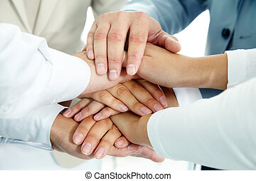 Cooperation - Image of businesspeople hands on top of each ...