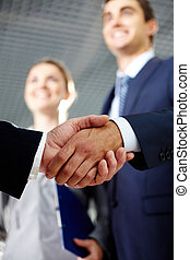 Cooperation - Close-up of two men hands shaking after...