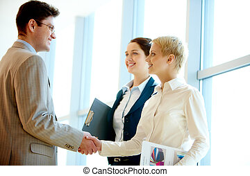 Cooperation - Photo of successful business partners...