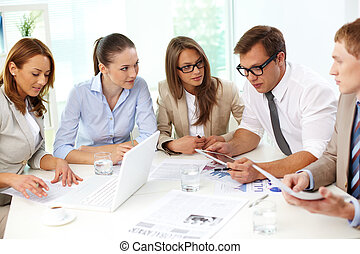 Cooperative colleagues - Business colleagues analyzing the...