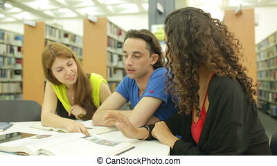 Cooperative Learning - Three group mates discussing new...