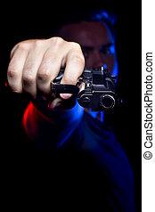 Cop or Criminal Holding a Gun