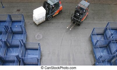 Baggage loaders work in port
