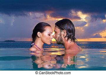 Copile at Maldives - Romantic couple alone in infinity...