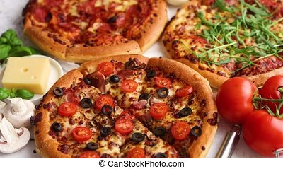 Coposition of italian or american pizzas with ingredients on...
