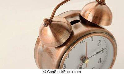 copper alarm clock calls and rotates on circle