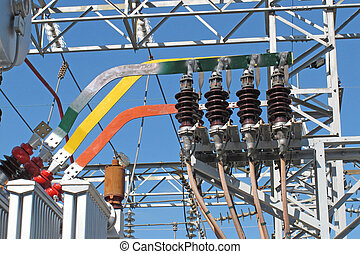copper bars and insulators of electricity transformers in a electrical substation