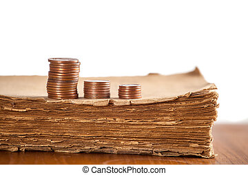 Copper coins on old book