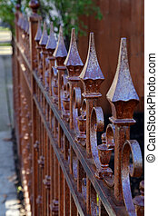 Copper colored metal fence
