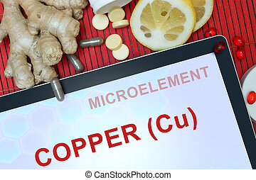 Copper (Cu) - Tablet with words Copper (Cu). Healthy eating.