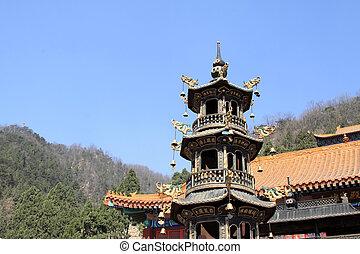 copper incense burner in a temple
