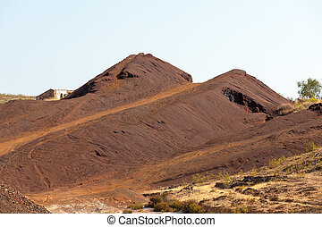 Copper mine tailings or refuse heaps remaining at a mine...