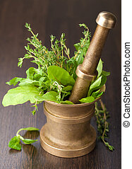 copper mortar with herbs
