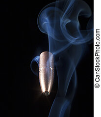 Copper plated bullet and smoke on black