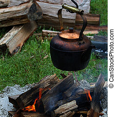 Copper pot over open fire - Copper pot hung over open...
