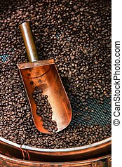 copper spoon in coffee beans