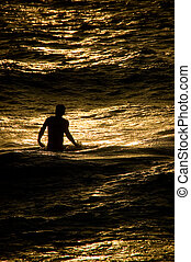 Copper Surf Boy - An image of a young man on Maui, standing...