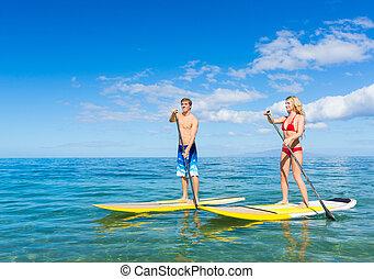 coppia, alzati, pagaia, surfing, in, hawai