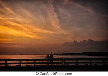 coppia, ara, rilassante, durante, tramonto