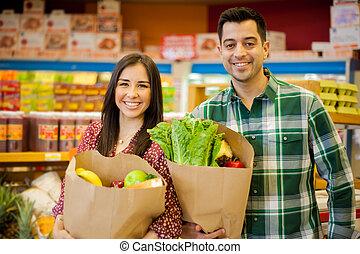 coppia felice, shopping, insieme