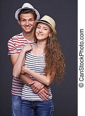 coppia, giovane, abbracciare, casuale
