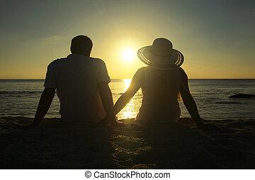 coppia, guardando, tramonto