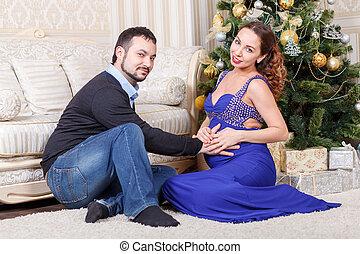 coppia, incinta, seduta