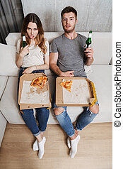 coppia, mangiare, infelice, pizza