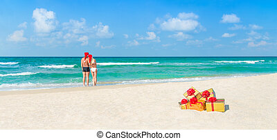 coppia, regali, cappelli, santa, vacanza, spiaggia, natale