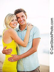 coppia romantica, vacanza, attraente, spiaggia, tramonto, felice