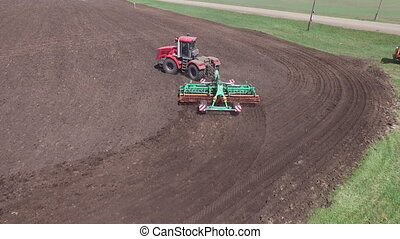 copter flight over the field and a tractor stock footage, aerial view