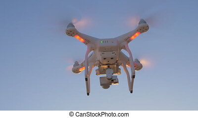 Copter flying in the evening sky - Drone with blinking...