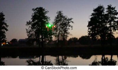Copter night lake drone - Copter stands in the lake before...