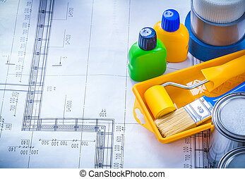 Copy space image of blueprint with paint brush tray roller...