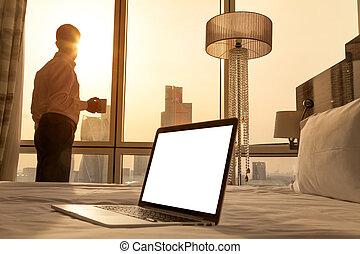 Copy space laptop in cozy sunny room