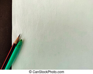 Copy space of green ink pen and red pencil isolated on green background