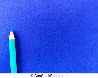 Copy space of Green ink pen isolated on blue background.