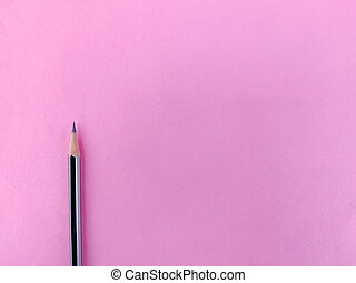 Copy space of one black color pencil with sharp lead isolated on pink background